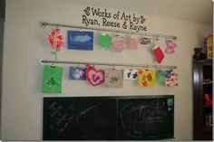 kids art display DIY, on curtain rod