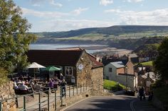 Enjoy a day out exploring the breath-taking Yorkshire coast, including fabulous Robin Hoods Bay less than half an hour by car. Yorkshire Cottages, Robin Hoods Bay, Luxury Holiday Cottages, Real Fire, North York, Yorkshire England, Beaches In The World, Beach Tops, Luxury Holidays