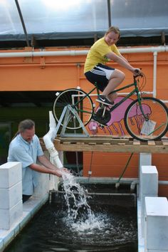 human powered water pump.  I have the bike, need a stand anyway, I wonder if this would be a way to water our garden?