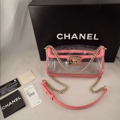 Nwt gorgeous chanel NIB Chanel Le Boy PVC Transparent Patent Leather Pink Gold Chain Small Bag   ********** Chanel **********   Brand: Chanel Size: Small (9x4.5x2) Name: Le Boy Color: Pink/Clear Style: Shoulder Bag Material: Patent Leather/PVC Retail: $4100+tax = $4400 Patent pink leather Le Boy 2013 cruise runway collection Front le boy lock Gold hardware Can be worn on one strap or two straps Chanel engraved gold side chain plates Clear plastic PVC throughout Pictures doesn't do this bag…