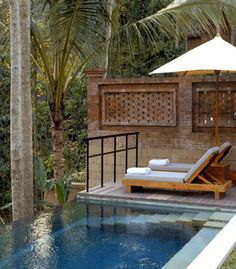 A pair of chaise-lounges by the infinity pool - perfect for reading a book together.