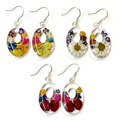 Real Flower Earrings Medium Classic Oval Dangle. The flowers are real flowers grown without fertilizers or pesticides. Earrings are made through cottage industry in Taxco Mexico.  Margarito Santos and his brother started the business and with a small team of workers they grow the flowers and make the jewelry in their homes, encasing and preserving the flowers. Fair Trade!