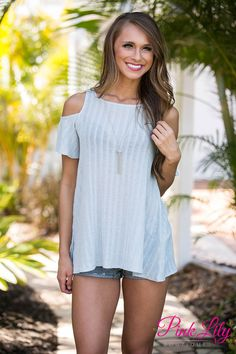 Start a new day wearing this adorable cold shoulder blouse! The light blue color is so sweet and the soft, lightweight material will make it your favorite!