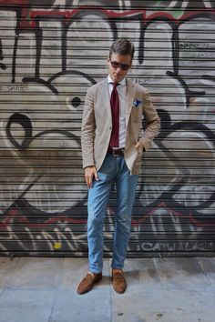 Light brown blazer, white shirt, maroon knit tie, light blue jeans, brown suede tassel loafers