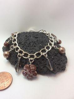 A personal favourite from my Etsy shop https://www.etsy.com/uk/listing/465102827/genuine-jasper-and-smokey-quartz