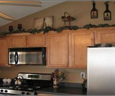 Over Kitchen Cabinets Wine Theme Ideas on wine closet ideas, wine kitchen curtains, wine glass ideas, wine storage cabinets, wine bar ideas, wine bedroom ideas, wine bar in kitchen, wine doors ideas, wine shower ideas, painted wine cabinet ideas, wine wallpaper ideas, wine decorating ideas, wine shelves ideas, wine rack cabinet, kitchen wet bar ideas, wine fridge ideas, wine art for kitchen, wine kitchen frederick md, wine kitchen decor, wine country style kitchen decorating,