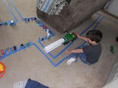 painters tape + hotwheels = hours of indoor fun!
