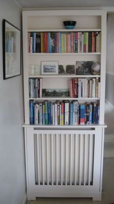 Use these radiator cover ideas to transform your room. See how to use a radiator cover for storage, reading nooks under windows, corner cabinets + more. Diy Radiator Cover, Radiator Shelf, Radiator Ideas, Built In Bookcase, Bookshelves, Kitchen Radiator, Decorative Radiators, Creation Deco, My Living Room