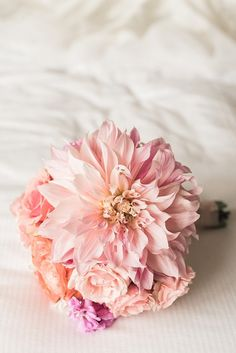 Blush dahlia and rose wedding bouquet: http://www.stylemepretty.com/2017/05/16/blush-gold-classic-chicago-cultural-center-wedding/ Photography: Two Birds - http://twobirdsphoto.com/