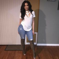 Olive green over the knee boots with white tee and distress jeans