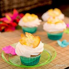 Lei on pineapple flowers for some extra aloha style! Click through to our Pineapple and Coconut cupcakes recipe to create these island confections.