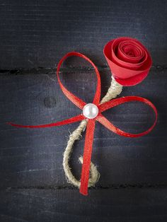 "Another discreet boutonniere, made of red paper flower, red satin ribbon and pearl with a handle made of natural rope. Length is 2.7 ""(7 cm). Comes with a pin. You can find me at:https://www.etsy.com/shop/LapelDesign"