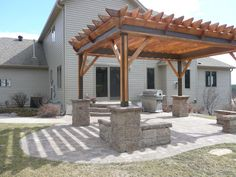 seating bench pergola patio | This home had a dark wooden deck with railing and four steps down to ...