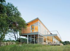 ThisMartha's Vineyard homefeatures aninverted hip roof that elevates the ceilings at the edges rather than the middle, opening therooms to sunshine, sea breezes, and panoramic vistas.  Photo by: Iwan Baan