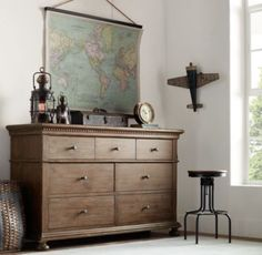 Great map, lantern, plane, dresser could be used as a changing table #RHBabyandChild #Mothermag