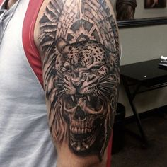 Jaguar and skull tattoo