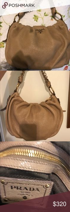 Authentic Prada Leather Shoulder Hobo Authentic Prada Leather Hobo is in awesome condition no marks inside or out. It is a gold Shimmery Taupe . Prada Bags Hobos