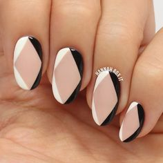 Try topping a nude base with a simple black and white angular outline for a geometric monochrome manicure.