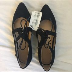Black Suede Pointed Toe Flats New With Tags. Soft and ties up in the middle. Size 7. Shoes Flats & Loafers