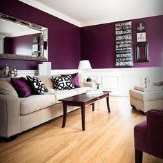 Create a dramatic space with a dark, elegant purple. Paired with neutral furniture, light wood flooring, and white painted wainscoting, allows for the room to stay bright and spacious.