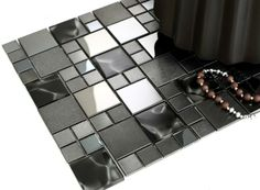 Mosaic Tile - Nova Deko manufactured decent mosaic wall tiles from brushed and polished stainless steel with glass in smokey black hues for modern home and office. Mosaic Wall Tiles, Mosaic Glass, Mosaics, Black Smokey, Natural Stones, Home Furnishings, Home Accessories, Nova, Vanity
