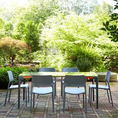 Knoll - the Spark Series Side Chair;brings energy to any room, or patio, with its bright colors and unique personality. A perfect balance of design and utility, the chairs are pleasing to the eye, comfortable and versatile. Outdoor Dining Chairs, Outdoor Garden Furniture, Outdoor Tables, Outdoor Decor, Outdoor Living, Rectangle Table, Extruded Aluminum, Indoor Air Quality, Side Chairs
