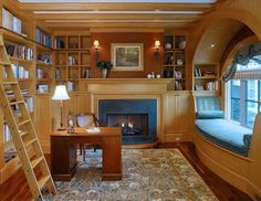 This house has the perfect home office for a book lover!! There's a writing desk, wall-to-wall bookshelves, and even a window reading nook!!