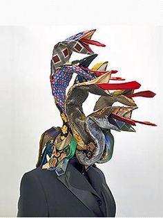 Guerra de la Paz - Snakes textile sculpture from old ties.