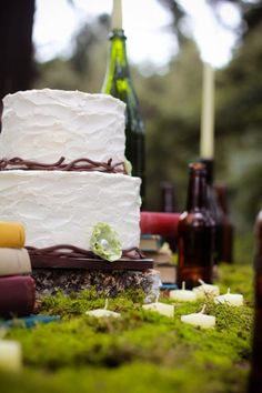 rustic wedding cake and moss