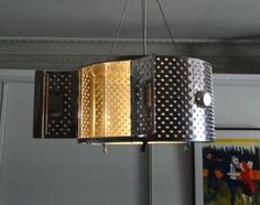 Pendant lamp made from a washing machine drum.