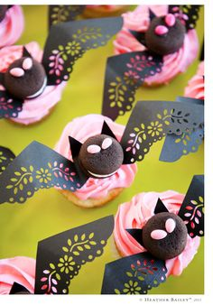 Bat cupcakes, made girly with decorative wings punched from a Martha Stewart craft punch.