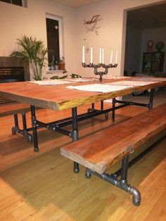 """2"""" 4'x8' Doug Fir live edge table with benches on 1 1/4"""" steel pipe legs. 3/4"""" candelabra"""