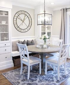 Eat in Kitchen w/ Storage---looks a little like DIY built ins with IKEA bookshelves. Love the bench, clock & chandelier