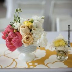 wonky, ruffly flowers in milk glass vase | CHECK OUT MORE IDEAS AT WEDDINGPINS.NET | #weddings #weddingflowers #weddingbouquets #bouquets