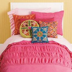 Sweet, simple and a whole bunch of fun, this Pink Ruched Bedding Set features gathered ruche accenting on a bright, lively backdrop. Passes the girly girl test with ease, especially when you pair it with our Lt. Pink sheets and coordinating throw pillows (sold separately). 200-thread count. Comforter cover available in Twin or Full-Queen. Machine wash. $19-$129. Free shipping. Buy here.