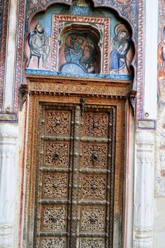 Intricately carved wooden door.
