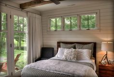 Horizontal plank wall for bedroom. Great neutrals, with exterior greens being some nice accent.