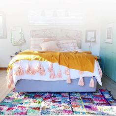 Love this dreamy bedroom with a color splash from the Moroccan Boucherouite rug from Beyond Marrakech! Image from The Beetle Shack  Lots of Moroccan rugs available on my website www.beyondmarrakech.com