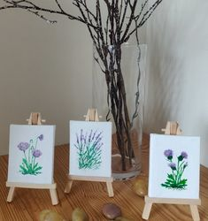 This beautiful original art trio was inspired by my love of the Northern Irish countryside and the many wildflowers seen on my walks. The set includes three hand-painted miniatures - poppies, lavender and thistles, painted with acrylics on canvas and finished with two layers of protective lacquer.