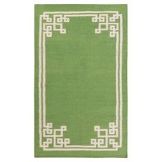 Wool rug with a geometric-inspired border. Hand-woven in India.  Product: RugConstruction Material: 100% WoolColor: Spinach green and silver cloudFeatures:  Hand-wovenMade in IndiaFlatweave  Note: Please be aware that actual colors may vary from those shown on your screen. Accent rugs may also not show the entire pattern that the corresponding area rugs have.Cleaning and Care: Blot stains
