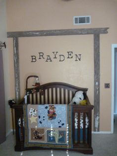 Crib wall is accented with ranch gate entrance (used old barn wood to create arch) and Brayden's name. Rustic metal Letters were purchased on ETSY.