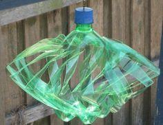 Fun Fun Fun!!! Soda bottle made to a yard wind spinner.  Hmmmm I. Gotta try this