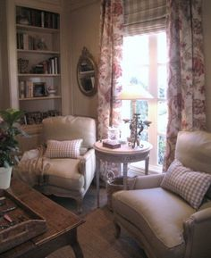 cote de texas/like the furniture arrangement in front of the window./ Floor lamps behind the chair for reading or needlework