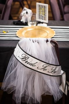 Adorn bride's chair at bridal shower with tulle resembling a veil!