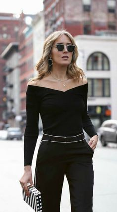 black double v off the shoulder knit sweater top, black wide leg pants with white piping, silver statement hoop geometric earrings // pajama trend, tibi, layered chokers