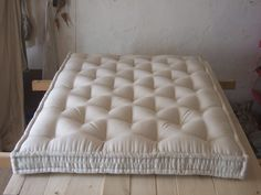 French artisanal wool mattress production.
