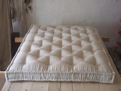 French artisanal wool mattress production.
