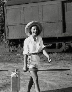 This picture is my grandmother's friend Joy  arriving at the Canoe Lake Station in 1948. ( from the Sartorialist)