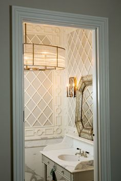 Windsor Smith for Arteriors Hera Oval Chandelier and Hera Mirror Sconce inside Windsor's California home.