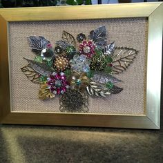 A sumptuous floral bouquet in a vase. This picture is made entirely using vintage and new jewelry along with some beads, pearls and rhinestones. This